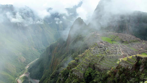 Peru Machu Picchu ancient inca ruin site Panorama with morning clouds