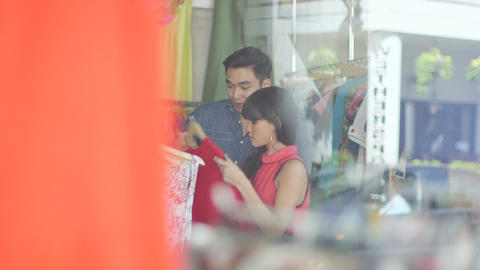 MLS Through Glass A Young Woman and Young Man browse clothes in a vintage store Live Action