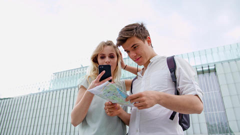 A Young Couple Using a Mobile Phone Outdoors Footage