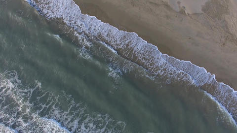 Piemanson beach and waves, Camargue, filmed vertically by drone, France Footage