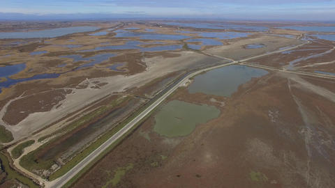 Ponds and marshes of Camargue, filmed by drone, Saintes-Maries-de-la-Mer, France Footage