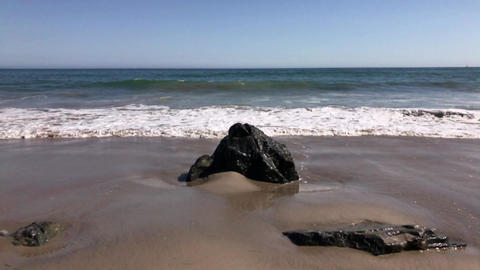 Rock and ocean waves Slow Motion Footage