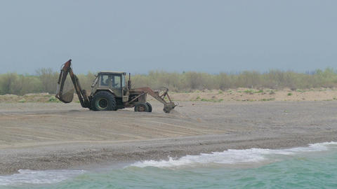 Tractor Working On The Beach Leveling Beach Footage