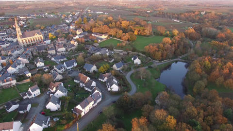 Aerial view by drone of Saint Lambert du Lattay at dusk, France Live Action