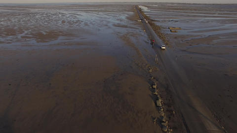 Aerial view by drone of the Passage du Gois high tide Noirmoutier side in winter Live Action