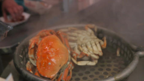Chef cooking crabs in a big pan Footage