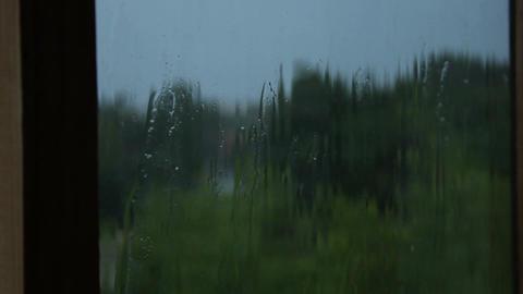 Heavy drops of cold autumn rain drumming on windowpane, flooding streets Footage