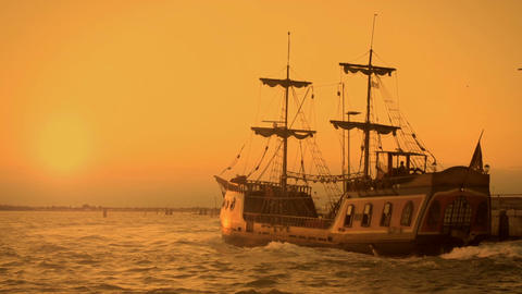 Old medieval ship gracefully sailing to open sea, travelling towards adventures Live Action