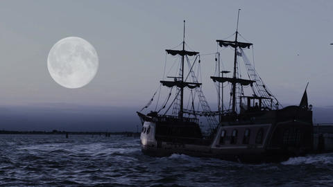 Ghostly pirate ship sailing towards horizon in endless blue ocean, moon in sky Footage