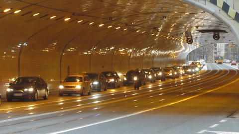 Automobiles driving with caution into tunnel equipped with new lights, traffic Footage