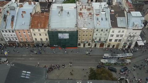 View from City Hall at peaceful movement of trams through narrow streets of Lviv Footage