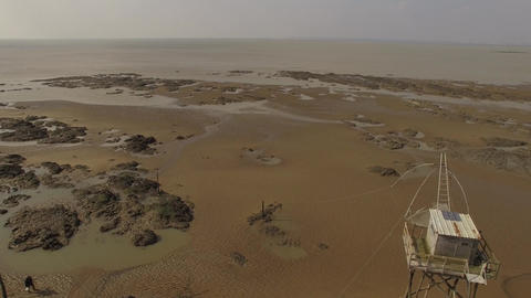 Aerial view by drone of a fishing site flounder at low tide, St Michel Chef Chef Footage