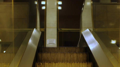Escalator carrying people between floors at shopping mall, transport device Footage