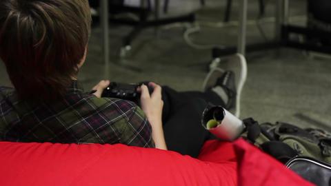 Teenager missing high school in virtual world of video games in gaming club Footage