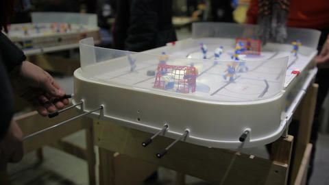 Men actively playing table hockey game at tablegames competition, wants to win Footage