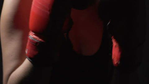 Close up of diligent aggressive woman shadow boxing in the gym, training hard Footage