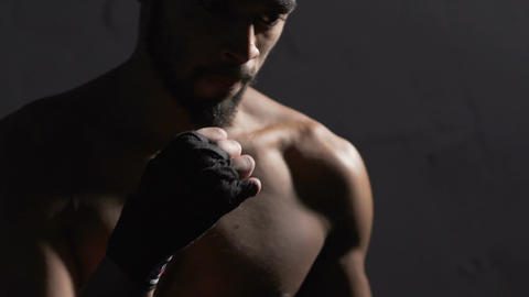 Biracial boxer fighting in the boxing gym, fighter standing in base position Footage