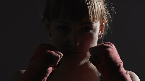 Strong independent female boxer looking into camera, fight for women rights Footage