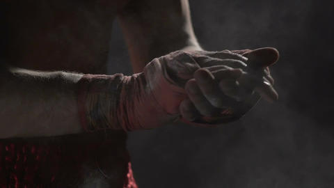 Muscular boxer clapping together hands with talcum powder, boxing workout Footage