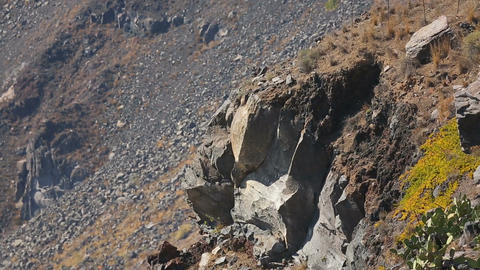 Volcanic rocks on ancient Santorini island, geology of caldera remnant soil Footage