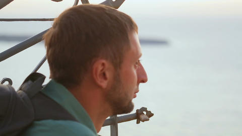 Thoughtful male traveller looking at endless sea, dreaming about adventures Footage