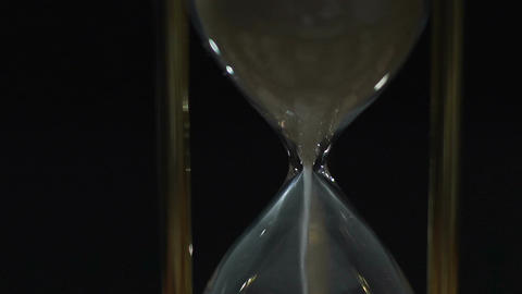 White sand running out in hour glass, life time expiring and coming to end Footage