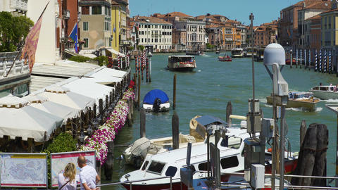 Tourists standing on pier and looking at city map, Grand Canal, cafe in Venice Footage