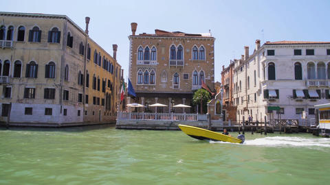 Man sailing along Grand Canal by motorboat, private water transport in Venice Footage