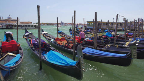 Gondoliers docking their gondola boats, business and profession, Venice, Italy Footage