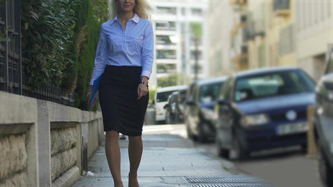 Female public defender hurrying to court hearing to represent clients interests Footage