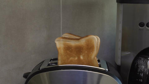 Ruddy toast synchronously jumping out of toaster attracting with crust and smell Footage