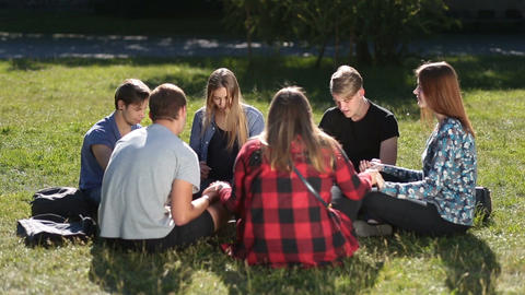 Young christians sitting in circle and praying Image