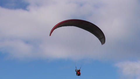 tandem paragliding slow descent and landing sequence Footage