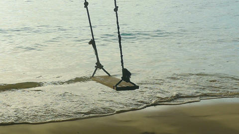 A rope swings on the beach, slow motion Footage