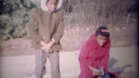 1971: African sisters find puppy in long winter warm coats Footage