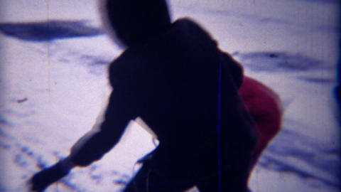 1971: Mixed race girl friends winter snowball fight closeup Footage