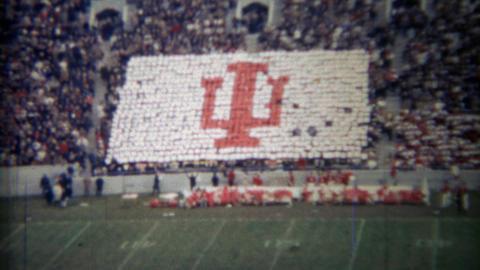 1971: Indiana University Football Crowd Participation Makes Team Logo stock footage