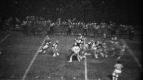 1978: High school football night game receiver diving catch fail Footage