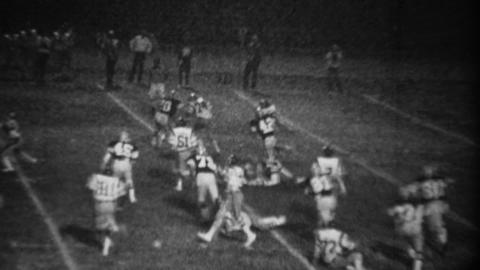 1978: High school football night game running back gets 1st down Footage