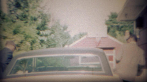1969: African men wearing sunglasses enter long white Lincoln car Footage
