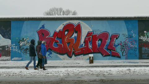 15 Berlin Wall Germany People Tourists Snow East Side Gallery stock footage