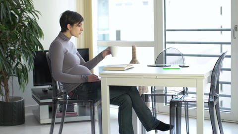 Pregnant Woman Relaxing At Home Reading Book Drinking Coffee Tea stock footage