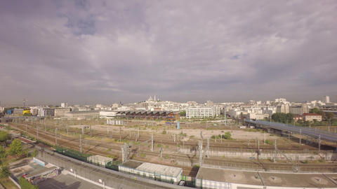 Aerial view of Paris from Les Jardins d'Eole with Gare du nord railway in foregr Footage