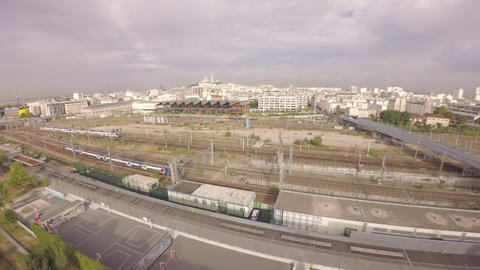 Aerial tilt up of cityskyline from Les Jardins d'Eole with Gare du nord railway  Footage