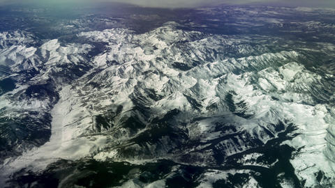 Aerial view over snow-capped Rocky Mountains, 4K Footage