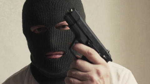 man in a mask terrorist threat weapon Live Action