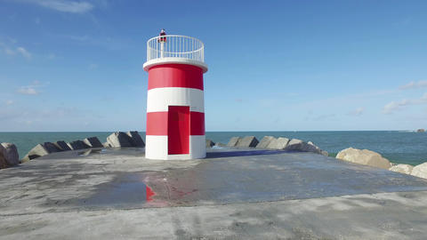 Walk Near the Lighthouse on the Breakwater Footage