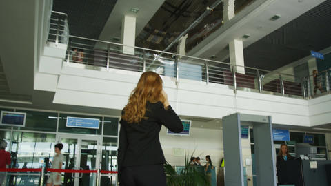 Backside View Woman in Office Suit Walks along Bussines Centre Footage