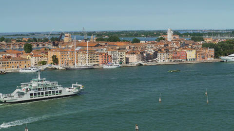Ferry sailing down Venice canal, water transportation, view of architecture Footage