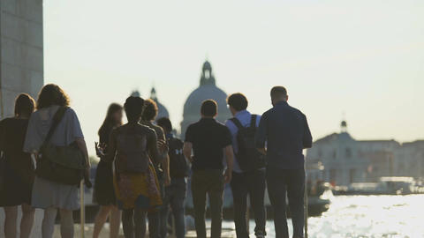 Group of multi-ethnic tourists walking in Venice, view of Grand Canal, tourism Footage